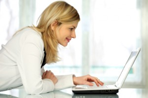 Woman browsing nyc beauty buzz on facebook